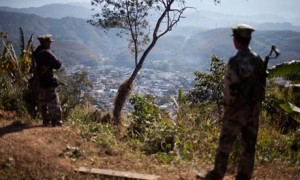 Kachin Independence Army soldiers guard a post on a hilltop overlooking the town of Laiza. Photograph: Alexander F. Yuan/AP