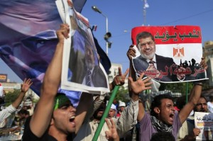 Supporters of ousted President Mohammed Morsi chant slogans during a rally. (Source: AP Hassan-Ammar) jpg