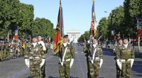 July, 14th, 2013: 4800 soldiers march along the Champs-Élysées in Paris to celebrate the French National Day. Among them were 200 German soldiers – members of the Franco-German Brigade, accompanied ...