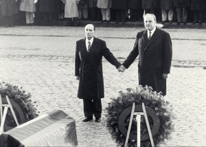 French President Mitterrand and German Federal Chancellor Kohl participated in a memorial service for fallen soldiers at Verdun in 1984 . As the national anthems of both countries played, Mitterand and Kohl joined hands – a gesture of friendship symbolizing the lessons learned from a frightful past.