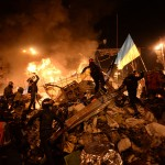 SState_flag_of_Ukraine_carried_by_a_protester_to_the_heart_of_developing_clashes_in_Kyiv,_Ukraine._Events_of_February_18,_2014