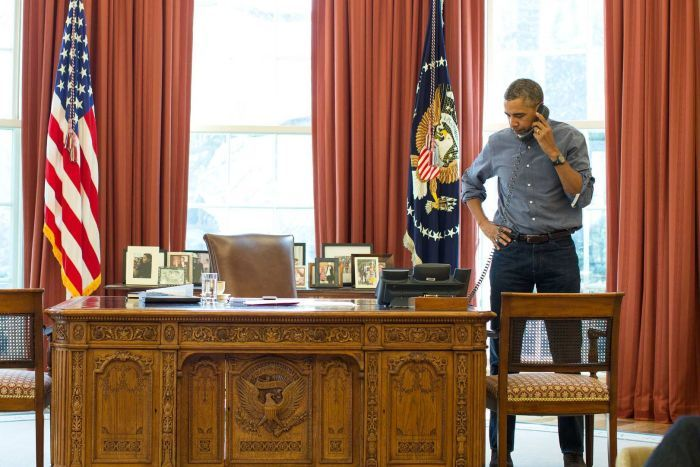 President Obama on the phone with Russian President Putin